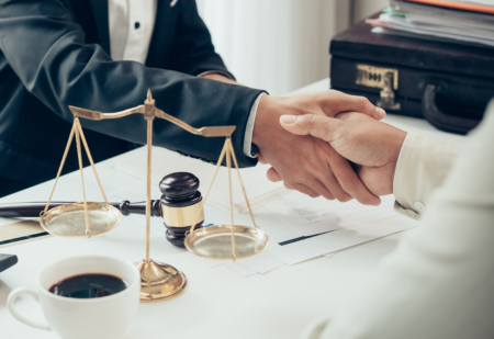 Businessman shaking hands to seal a deal with his partner lawyer